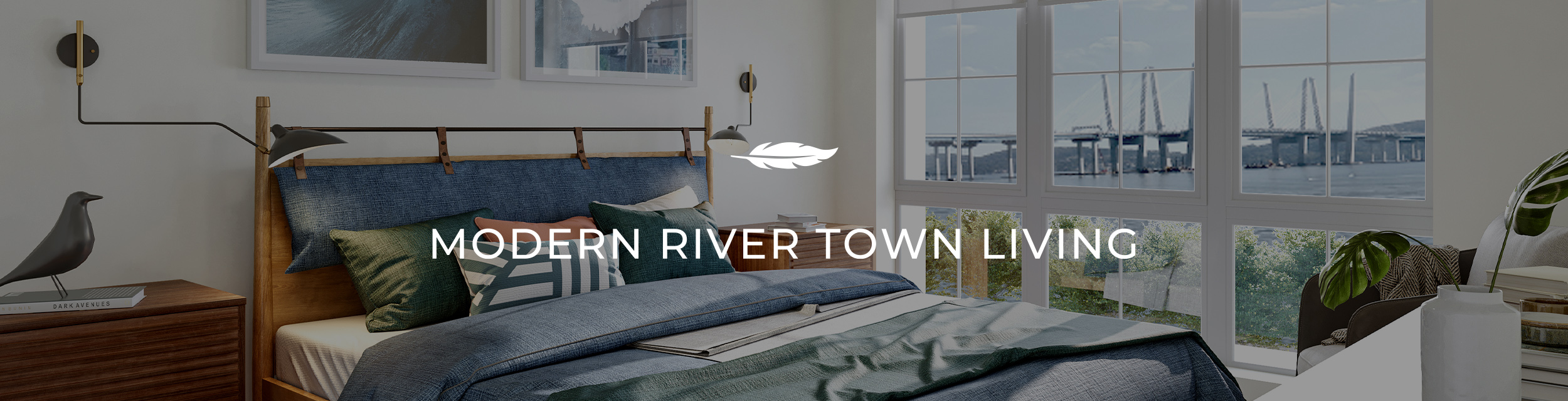 Emerson bedroom overlooking the water. Text: Modern River Town Living.