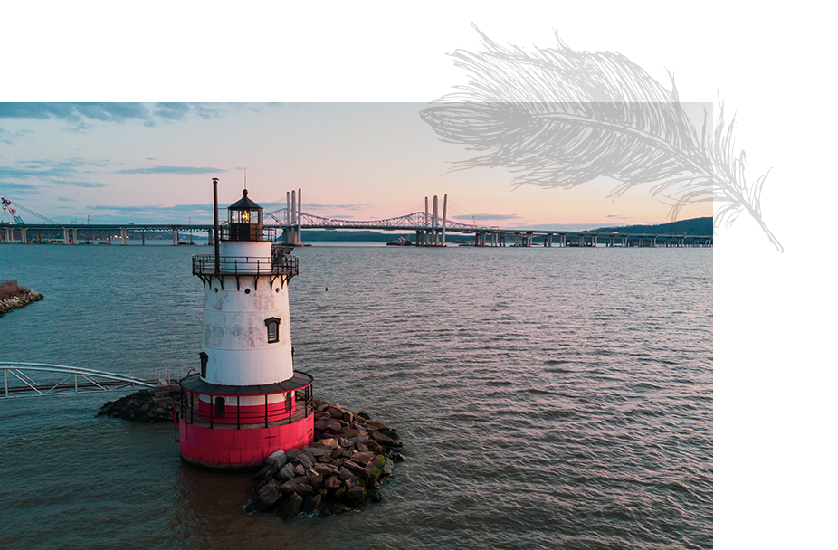 Lighthouse in the water overlooking the bridge